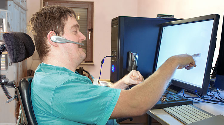 Man with cerebral palsy using a computer