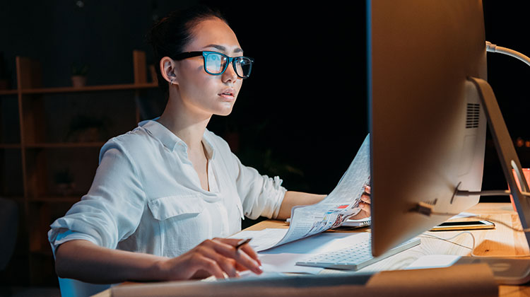Woman working intently at computer