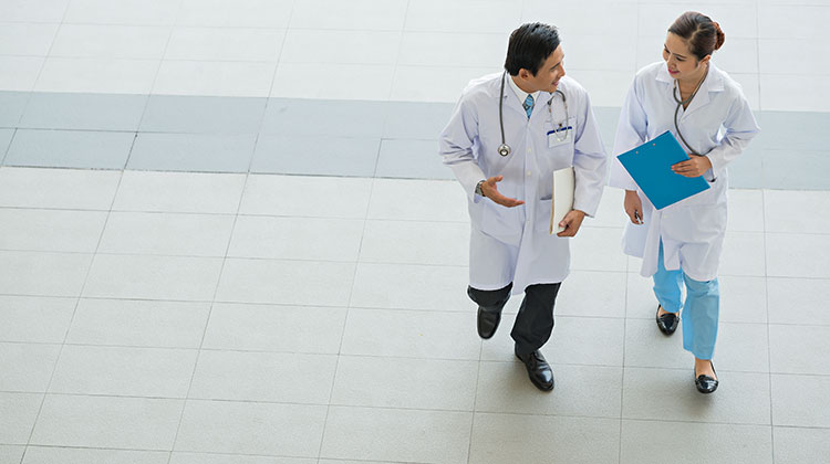 Two physicians walking and talking