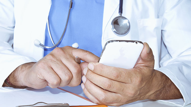 Closeup of doctor using smartphone